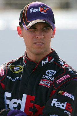 LOUDON, NH - SEPTEMBER 18:  Denny Hamlin, driver of the #11 FedEx Freight Toyota, prepares to drive during qualifying for the NASCAR Sprint Cup Series Sylvania 300 at the New Hampshire Motor Speedway on September 18, 2009 in Loudon, New Hampshire  (Photo 