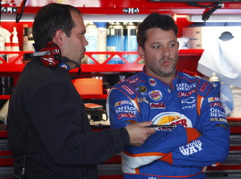 DOVER, DE - SEPTEMBER 26: Tony Stewart (R), driver of the #14 Burger King Chevrolet, talks with crew chief Darian Grubb after practice for the NASCAR Sprint Cup Series AAA 400 at Dover International Speedway on September 26, 2009 in Dover, Delaware.  (Pho