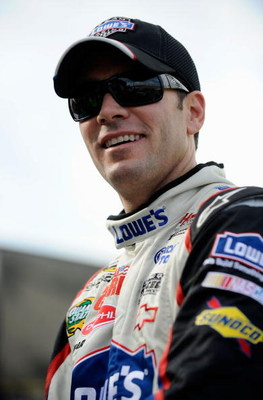 DOVER, DE - SEPTEMBER 25:  Jimmie Johnson, driver of the #48 Lowe's Chevrolet climbs out of his car during qualifying for the NASCAR Sprint Cup Series AAA 400 at Dover International Speedway on September 25, 2009 in Dover, Delaware.  (Photo by Jeff Zeleva