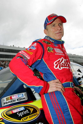 DOVER, DE - SEPTEMBER 27:  Mark Martin, driver #5 of the Kellogg's/CARQUEST Chevrolet, waits by his car before the NASCAR Sprint Cup Series AAA 400 at Dover International Speedway on September 27, 2009 in Dover, Delaware.  (Photo by Todd Warshaw/Getty Ima