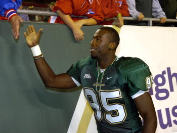 TAMPA, FL - NOVEMBER 17: Defensive end George Selvie #95 of the University of South Florida Bulls greets fans after play against the Louisville Cardinals at Raymond James Stadium on November 17, 2007 in Tampa, Florida.  South Florida won 55-17.  (Photo by