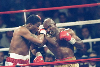 4 Nov 1995:  Riddick Bowe (left) and Evander Holyfield III trade blows during a bout at Caesar''s Palace in Las Vegas, Nevada.  Bowe won the fight with a technical knockout in the eighth round. Mandatory Credit: Holly Stein  /Allsport