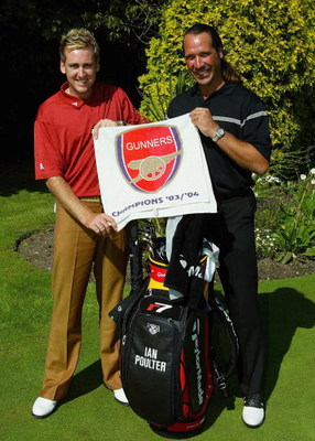 SUNNINGDALE, ENGLAND - SEPTEMBER 6:  Ian Poulter (L) of England poses with former England goalkeeper David Seaman as they hold an Arsenal towel at the inaugural TAG Heuer LINK Challenge at Sunningdale Golf Club on September 6, 2004 in Sunningdale, England