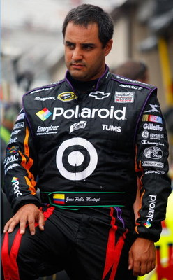 DOVER, DE - SEPTEMBER 26:  Juan Pablo Montoya, driver of the #42 Polaroid Chevrolet, waits in the garage area during practice for the NASCAR Sprint Cup Series AAA 400 at Dover International Speedway on September 26, 2009 in Dover, Delaware.  (Photo by Geo