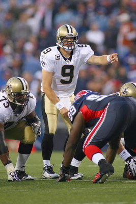ORCHARD PARK, NY - SEPTEMBER 27:  Quarterback Drew Brees #9 of the New Orleans Saints calls the play during the game against the Buffalo Bills at Ralph Wilson Stadium on September 27, 2009 in Orchard Park, New York. The Saints won 27-7. (Photo by Rick Ste
