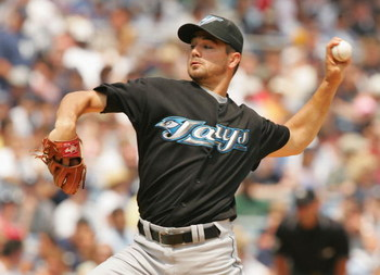 NEW YORK - JULY 22: Ted Lilly of the Toronto Blue Jays pitches against the New York Yankees during their game on July 22, 2004 at Yankee Stadium in the Bronx borough of New York City.  (Photo by Al Bello/Getty Images)