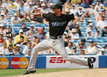 NEW YORK - AUGUST 03:  Scott Schoeneweis #60 of the Toronto Blue Jays pitches against the New York Yankees at Yankee Stadium on August 3, 2006 in the Bronx borough of New York City. The Yankees defeated the Blue Jays 8-1.(Photo by Jim McIsaac/Getty Images