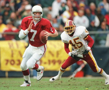 10 Nov 1996: Boomer Esiason #7 of the Arizona Cardinals runs from Washington Redskins defenders during the Cardinals 37-34 overtime win at RFK Stadium in Washington DC.