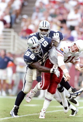 7 Sep 1997:  Quarterback Kent Graham of the Arizona Cardinals gets tackled by linebackers Dexter Coakley and Darryl Hardy of the Dallas Cowboys during a game at Sun Devil Stadium in Tempe, Arizona.  The Cardinals won the game, 25-22. Mandatory Credit: Jed