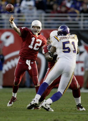TEMPE, AZ - DECEMBER 28:  Quarterback Josh McCown #12 of the Arizona Cardinals throws a pass as teammate Reggie Wells #74 blocks Lance Johnstone #51 of the Minnesota Vikings  during their game December 28, 2003 at Sun Devil Stadium in Tempe, Arizona. The