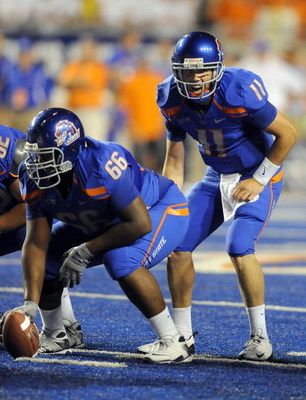 BOISE, ID - SEPTEMBER 3: Quarterback Kellen Moore #6 of the Boise State Broncos barks out signals as center Thomas Byrd #66 of the Boise State Broncos waits to snap the ball in the third quarter of the game against the Oregon Ducks at Bronco Stadium on Se