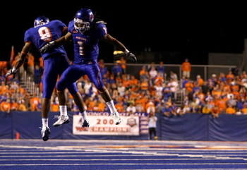 BOISE , ID - SEPTEMBER 13: Kyle Wilson #1 of the Boise State Broncos celebrates with teammate Jeremy Childs #9 after making an interception against the Bowling Green Falcons at Bronco Stadium on September 13, 2008 in Boise, Idaho. (Photo by Jonathan Ferre