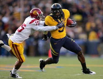 BERKELEY, CA - OCTOBER 03:  Jeremy Ross #3 of the California Golden Bears is tackled by Kevin Thomas #15 of the USC Trojans at California Memorial Stadium on October 3, 2009 in Berkeley, California.  (Photo by Ezra Shaw/Getty Images)