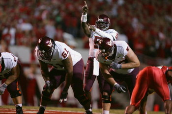 RALEIGH, NC - SEPTEMBER 4:  Quarterback Marcus Vick #5 of the Virginia Polytechnic Institute and State University Hokies calls a play during the game against the North Carolina State University Wolfpack at Carter-Finley Stadium on September 4, 2005 in Ral
