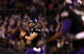 SAN DIEGO, CA - DECEMBER 23:  Quarterback Andy Dalton #14 of  TCU throws the ball against Boise State during the San Diego County Credit Union Poinsettia Bowl at Qualcomm Stadium on December 23, 2008 in San Diego, California. (Photo by Donald Miralle/Gett