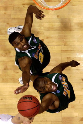 DAYTON, OH - MARCH 20: Alex Franklin #42 and Edwin Ubiles #23 of the Siena Saints go for a rebound against the Ohio State Buckeyes during the first round of the NCAA Division I Men's Basketball Tournament at the University of Dayton Arena on March 20, 200