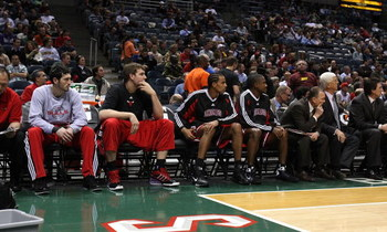 MILWAUKEE - FEBRUARY 18: (L-R) Kirk Hinrich #12, Aaron Gray #34, Thabo Sefolosha #2 and Lindsey Hunter #11 of the Chicago Bulls make up the bench players during a game against the Milwaukee Bucks on February 18, 2009 at the Bradley Center in Milwaukee, Wi