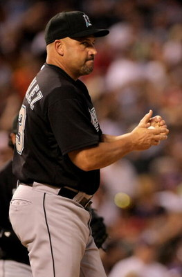 DENVER - JULY 03:  Manager Fredi Gonzalez #33 of the Florida Marlins makes a pitching change during action against  the Colorado Rockies at Coors Field on July 3, 2008 in Denver, Colorado. The Rockies defeated the Marlins 6-5 in 11 innings.  (Photo by Dou