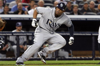 NEW YORK - SEPTEMBER 08:  Carl Crawford #13 of the Tampa Bay Rays is caught in a first inning rundown against the New York Yankees on September 8, 2009 at Yankee Stadium in the Bronx borough of New York City.  (Photo by Jim McIsaac/Getty Images)