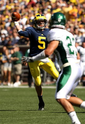ANN ARBOR, MI - SEPTEMBER 19:  Quarterback Tate Forcier #5 of the Michigan Wolverines throws a pass against the Eastern Michigan Eagles at Michigan Stadium on September 19, 2009 in Ann Arbor, Michigan.   Michigan won 45-17.  (Photo by Stephen Dunn/Getty I
