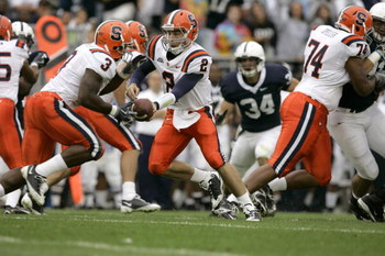 STATE COLLEGE, PA - SEPTEMBER 12: Quarterback Greg Paulus #2 of the Syracuse Orangemen hands off to running back Delone Carter #3 during the first half against the Penn State Nittany Lions at Beaver Stadium  September 12, 2009 in State College, Pennsylvan