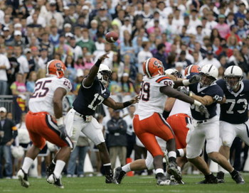 STATE COLLEGE, PA - SEPTEMBER 12: Quarterback Daryll Clark #17 of the Penn State Nittany Lions throws a pass against the Syracuse Orangemen during the first half against the Penn State Nittany Lions at Beaver Stadium  September 12, 2009 in State College,