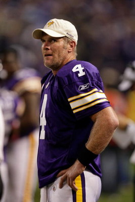 MINNEAPOLIS - OCTOBER 05:  Quarterback Brett Favre #4 of the Minnesota Vikings watches the reply from the sidelines after a touchdown during the game against the Green Bay Packers on October 5, 2009 at Hubert H. Humphrey Metrodome in Minneapolis, Minnesot