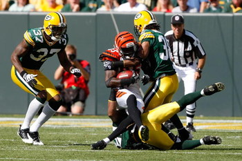 GREEN BAY, WI - SEPTEMBER 20: Wide receiver Chad Ochocinco #85 of the Cincinnati Bengals is tackled by several defenders after a pass reception against the Green Bay Packers at Lambeau Field on September 20, 2009 in Green Bay, Wisconsin. The Bengals defea