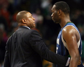 BOSTON - FEBRUARY 01:  Head coach Doc Rivers of the Boston Celtics talks to Al Jefferson #25 of Minnesota Timberwolves after the game on February 1, 2009 at TD Banknorth Garden in Boston, Massachusetts. The Celtics defeated the Minnesota Timberwolves 109-