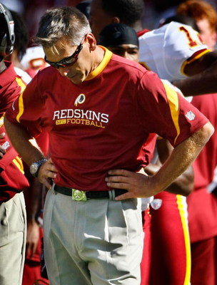 LANDOVER, MD - SEPTEMBER 20:  Head coach Jim Zorn of the Washington Redskins watches as his team runs out the clock against the St. Louis Rams during their game on September 20, 2009 at FedEx Field in Landover, Maryland.  The Redskins defeated the Rams by