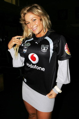 AUCKLAND, NEW ZEALAND - JUNE 11:  WWE wrestler Natalya poses for a photo with a Warriors team jersey after a Warriors NRL training session at Mt Smart Stadium on June 11, 2008 in Auckland, New Zealand.  (Photo by Sandra Mu/Getty Images)