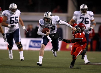 SALT LAKE CITY - NOVEMBER 22:  Max Hall #15 of the BYU Cougarsruns with the ball  against Brice McCain #1 of  the Utah Utes at Rice-Eccles Stadium on November 22, 2008 in Salt Lake City, Utah.  (Photo by Jonathan Ferrey/Getty Images)