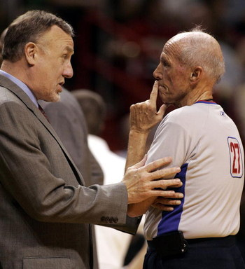 MIAMI - JANUARY 22:  Head Coach Rick Adelman of the Sacramento Kings chats with Referee Dick Bavetta against the Miami Heat on January 22, 2006 at the American Airlines Arena in Miami, Florida.  (Photo by Eliot J. Schechter/Getty Images)