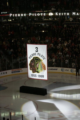 CHICAGO - NOVEMBER 12:  A banner retiring the number of former Chicago Blackhawks defenseman and NHL hall of famer Pierre Pilote is raised during a ceremony before the Chicago Blackhawks Boston Bruins game at the United Center on November 12, 2008 in Chic