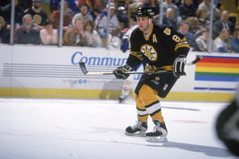 BUFFALO, NY - FEBRUARY 12:  Cam Neely #8 of the Boston Bruins pursues the play during the game against the Buffalo Sabres on February 12, 1995 in Buffalo, New York. The Sabres defeated the Bruins 2-1. (Photo by Rick Stewart/Getty Images)