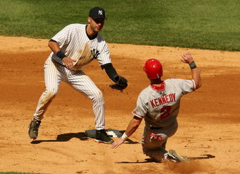 NEW YORK - AUGUST 13:  Derek Jeter #2 of the New York Yankees tags out Adam Kennedy #2 of the Los Angeles Angels of Anaheim at second August 13, 2006 at Yankee Stadium in the Bronx borough of New York City.  (Photo by Nick Laham/Getty Images)