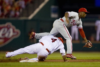 ST. LOUIS, MO - AUGUST 3: Jimmy Rollins #11 of the Philadelphia Phillies turns a double play over Yadier Molina #4 of the St. Louis Cardinals at Busch Stadium August 3, 2008 in St. Louis, Missouri.  (Photo by Dilip Vishwanat/Getty Images)