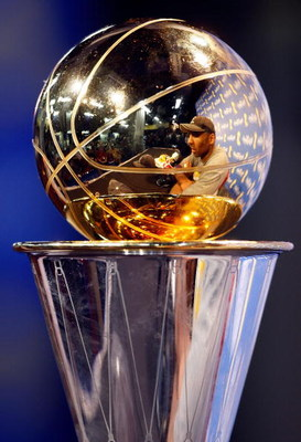 ORLANDO, FL - JUNE 14:  A reflection off of the Bill Russell MVP Trophy of Kobe Bryant #24 of the Los Angeles Lakers during the post game news conference after the Lakers defeated the Orlando Magic 99-86 to win the NBA Championship in Game Five of the 200