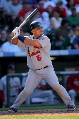 DENVER - SEPTEMBER 27:  Albert Pujols #5 of the St. Louis Cardinals takes an at bat against the Colorado Rockies at Coors Field on September 27, 2009 in Denver, Colorado. The Rockies defeated the Cardinals 4-3.  (Photo by Doug Pensinger/Getty Images)
