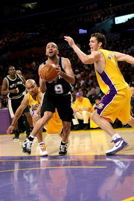 LOS ANGELES, CA - MAY 29:  Tony Parker #9 of the San Antonio Spurs goes to the basket in between Derek Fisher #2 and Luke Walton #4 of the Los Angeles Lakers in Game Five of the Western Conference Finals during the 2008 NBA Playoffs on May 29, 2008 at Sta