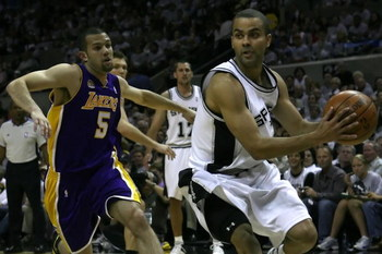 SAN ANTONIO - MAY 25:  Tony Parker #9 of the San Antonio Spurs drives past Jordan Farmar #5 of the Los Angeles Lakers in Game Three of the Western Conference Finals during the 2008 NBA Playoffs on May 25, 2008 at the AT&T Center in San Antonio, Texas. NOT