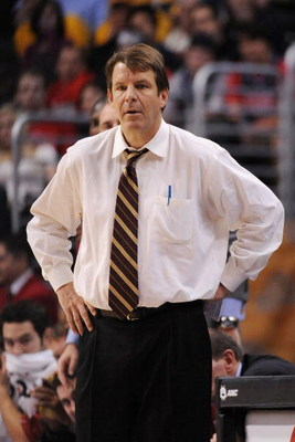 LOS ANGELES, CA - MARCH 12:  Head coach of the USC Trojans Tim Floyd watched game action against the California Golden Bears in the Pacific Life Pac-10 Men's Basketball Tournament at the Staples Center on March 12, 2009 in Los Angeles, California.  (Photo