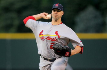 DENVER - SEPTEMBER 25:  Starting pitcher Chris Carpenter #29 of the St. Louis Cardinals delivers against the Colorado Rockies at Coors Field on September 25, 2009 in Denver, Colorado. The Rockies defeated the Cardinals 2-1.  (Photo by Doug Pensinger/Getty