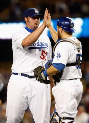 LOS ANGELES, CA - SEPTEMBER 14:  Jonathan Broxton (L) #51 of the Los Angeles Dodgers is congratulated by Russell Martin #55  after Boxton saved the game against the Pittsburgh Pirates at Dodger Stadium on September 14, 2009 in Los Angeles, California. The