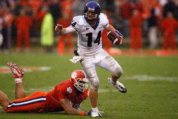 CLEMSON, SC - SEPTEMBER 26:  Andy Dalton #14 of the TCU Horned Frogs runs with the ball as Miguel Chavis #89 of the Clemson Tigers tries to tackle him during their game at Memorial Stadium on September 26, 2009 in Clemson, South Carolina.  (Photo by Stree