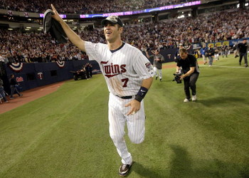 MINNEAPOLIS - OCTOBER 06:  Joe Mauer #7 of the Minnesota Twins circles the field after the Twins defeated  the Detroit Tigers to win the American League Tiebreaker game on October 6, 2009 at Hubert H. Humphrey Metrodome in Minneapolis, Minnesota.  (Photo