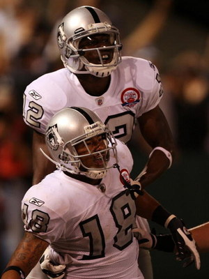 OAKLAND, CA - SEPTEMBER 14:  Louis Murphy #18 (bottom) and Darrius Heyward-Bey #12 of the Oakland Raiders celebrate after Murphy scored on a 57-yard touchdown reception in the fourth quarter against the San Diego Chargers on September 14, 2009 at the Oakl