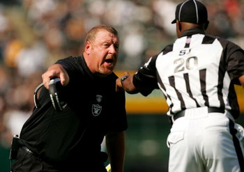 OAKLAND, CA - SEPTEMBER 27:  Oakland Raiders head coach Tom Cable argues with side judge Barry Anderson during their game against the Denver Broncos at the Oakland-Alameda County Coliseum on September 27, 2009 in Oakland, California.  (Photo by Ezra Shaw/
