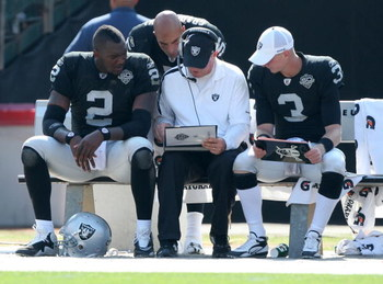 OAKLAND, CA - SEPTEMBER 27:  JaMarcus Russell #2 of the Oakland Raiders talks with a coach against the Denver Broncos on September 27, 2009 during an NFL game at the Oakland-Alameda County Coliseum in Oakland, California.  (Photo by Jed Jacobsohn/Getty Im