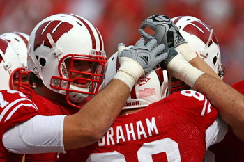 MADISON, WI - SEPTEMBER 26: Garrett Graham #89 of the Wisconsin Badgers is congratulated by teammates after catching his third touchdown pass against the Michigan State Spartans on September 26, 2009 at Camp Randall Stadium in Madison, Wisconsin. Wisconsi